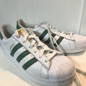 Adidas superstar with green stripe
